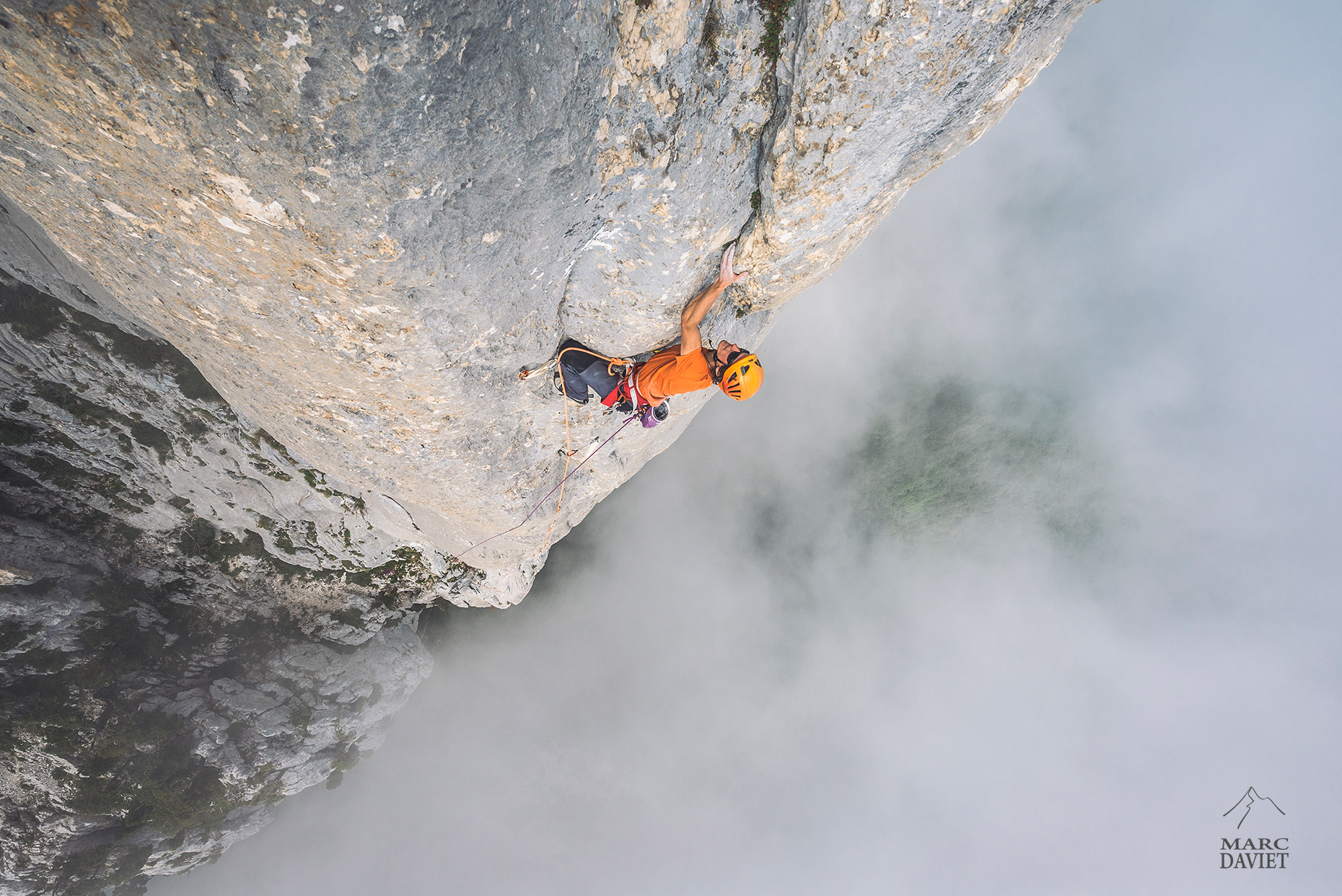 Climbing in the clouds - Marc Daviet Photography