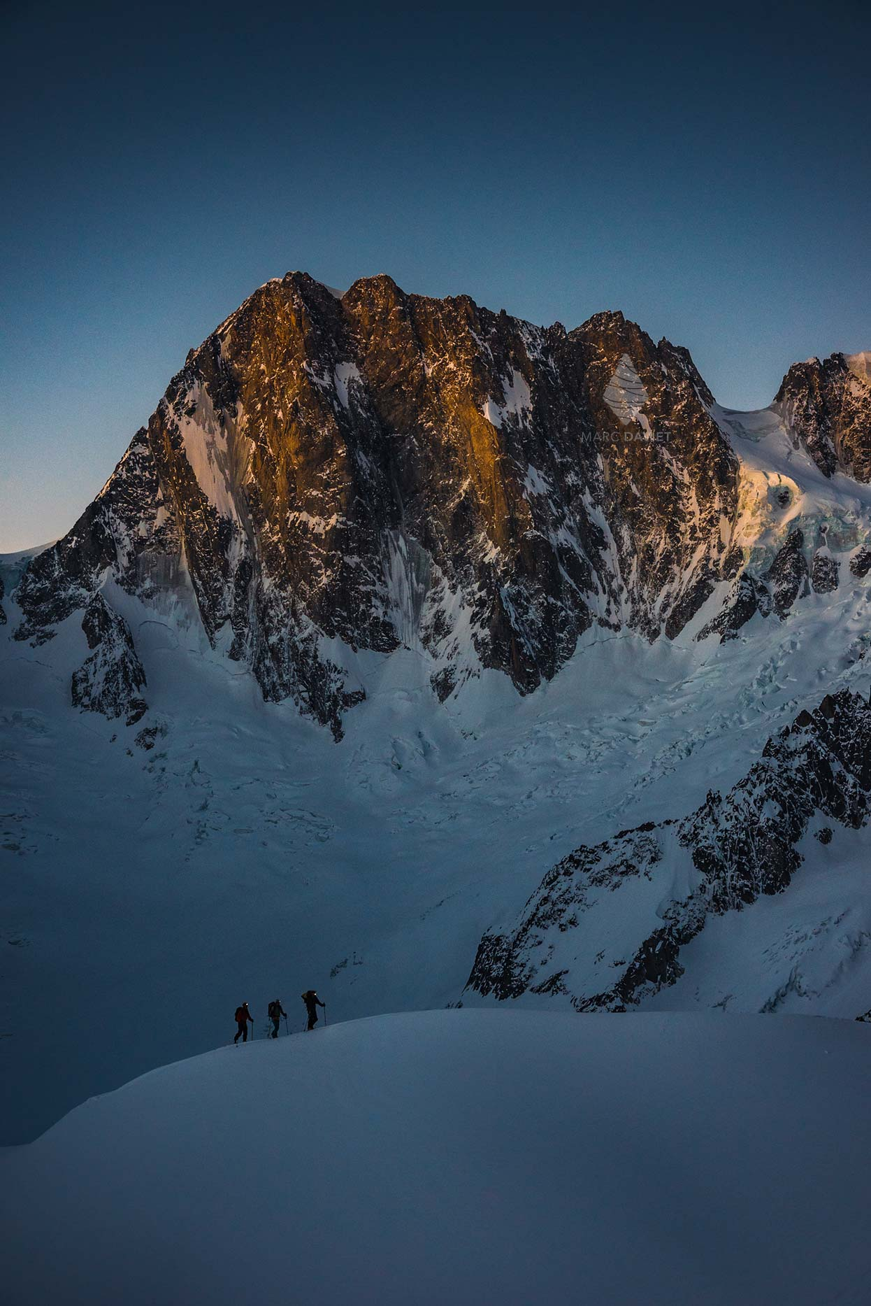 Grandes Jorasses with skiers